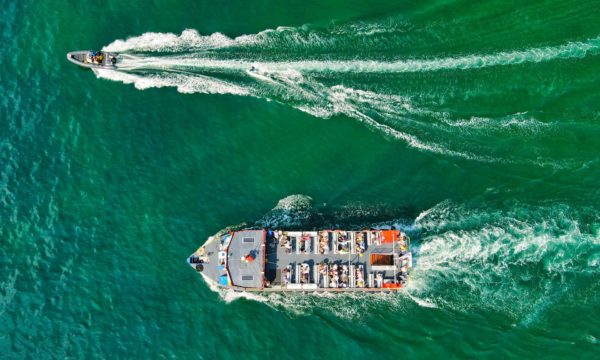 Aerial view of a large and small boat